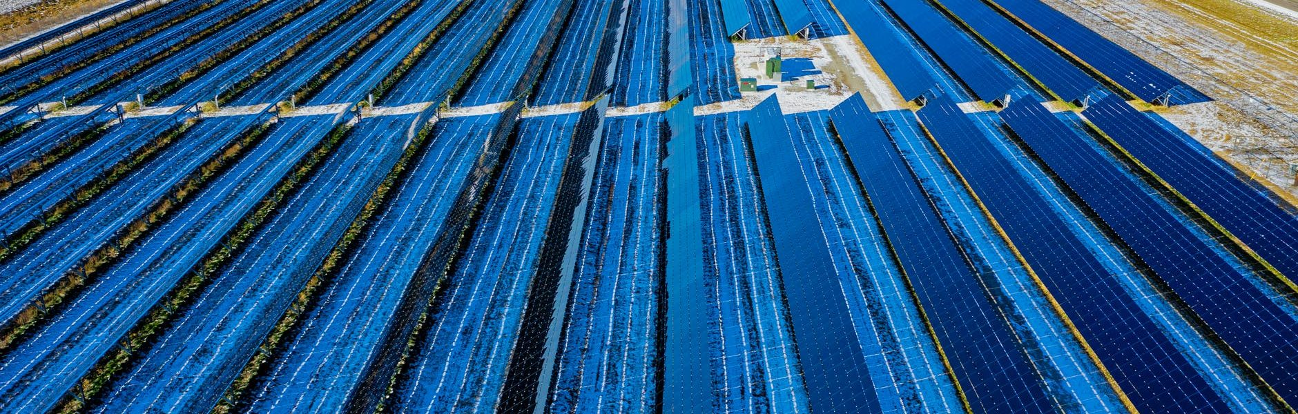 aerial photography of blue solar panels